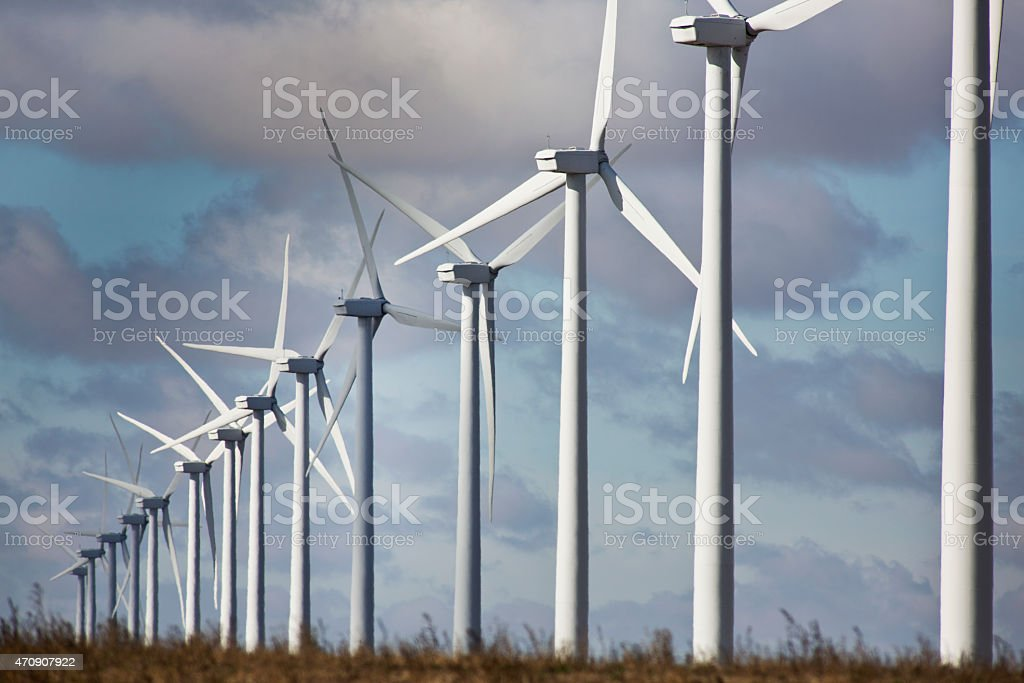 Wind Turbines in a Row in The Midwestern Landscape. stock photo