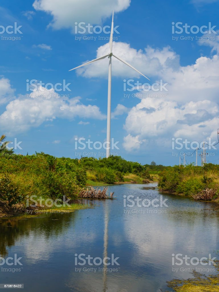 Wind turbines in a wind farm for green electricity generation stock photo