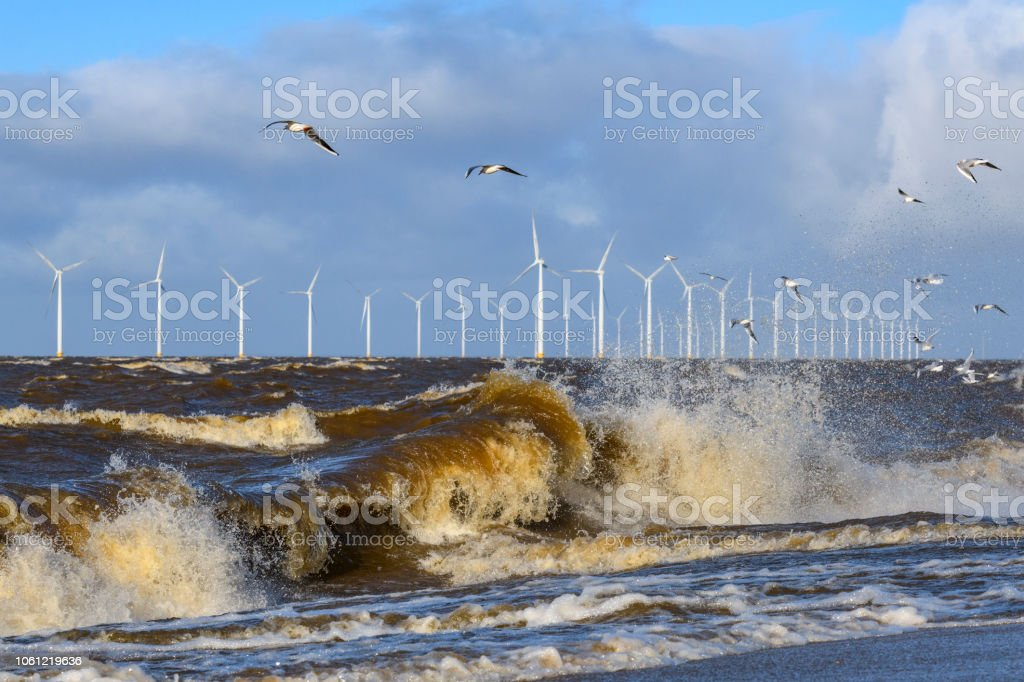 Wind turbines in an offshore wind park during a storm