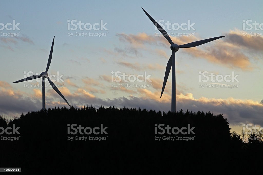 Wind turbines in the back light stock photo