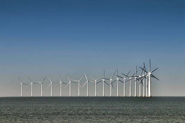 Wind turbines in the ocean stock photo