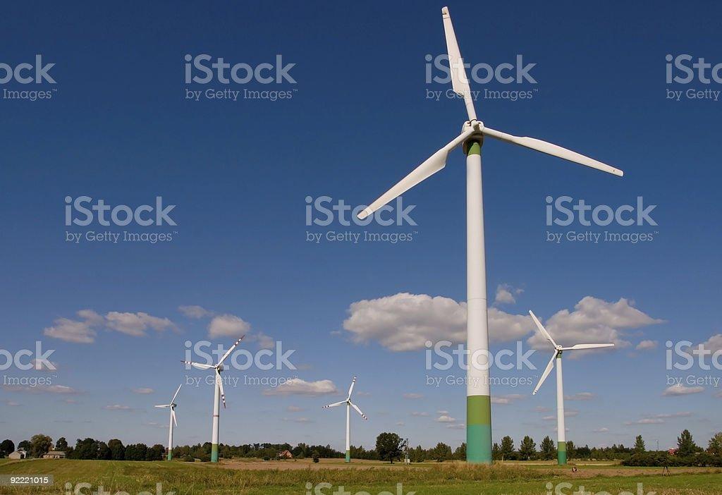 Wind turbines on field royalty-free stock photo