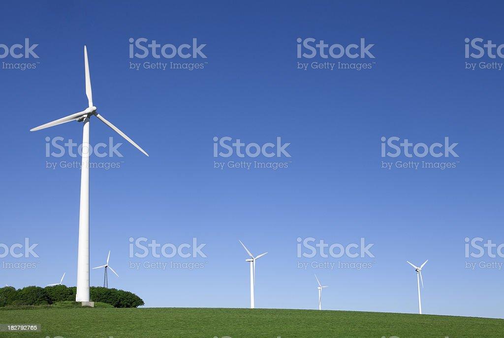 Wind Turbines on Green Field royalty-free stock photo