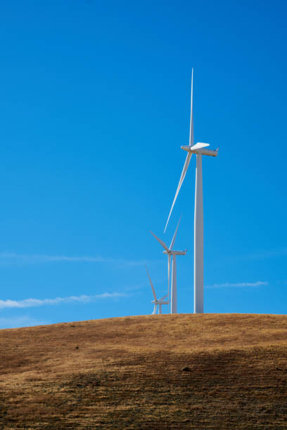 Wind turbines on hill stock photo