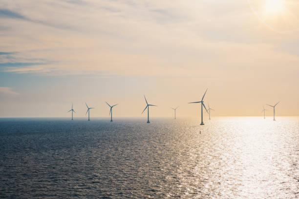 Wind turbines on the ocean. stock photo