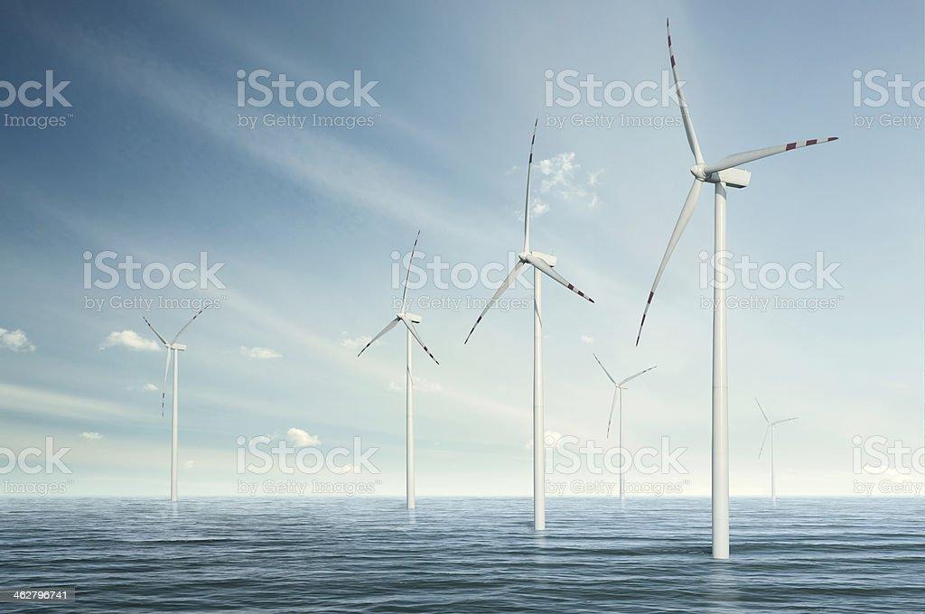 Wind turbines on the ocean stock photo