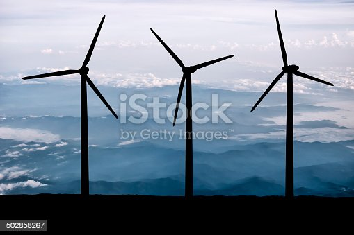 Wind turbines lit by morning's light