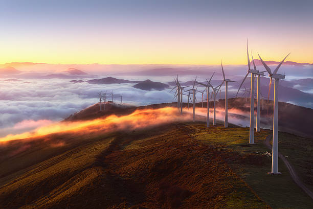 wind turbines wind turbines on the mountain windmill stock pictures, royalty-free photos & images