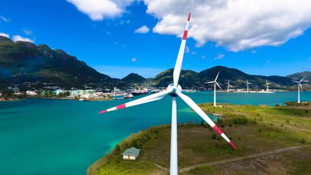 Wind Turbines producing alternative, Mahe Seychelles stock photo