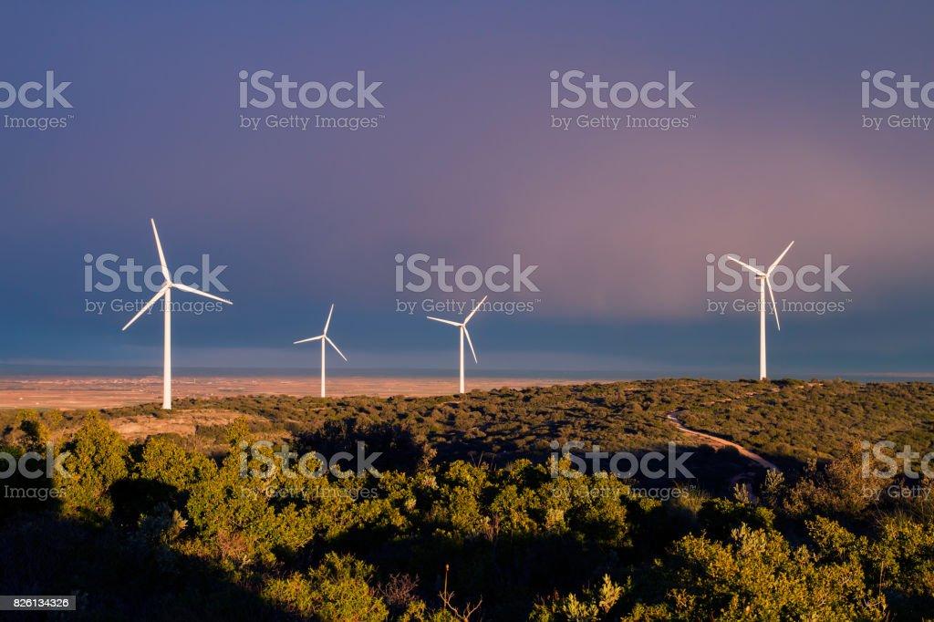 wind turbines, stormy sky stock photo