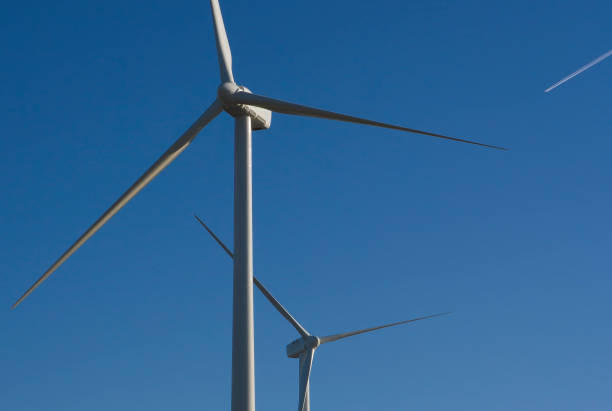 wind turbines with blue sky stock photo