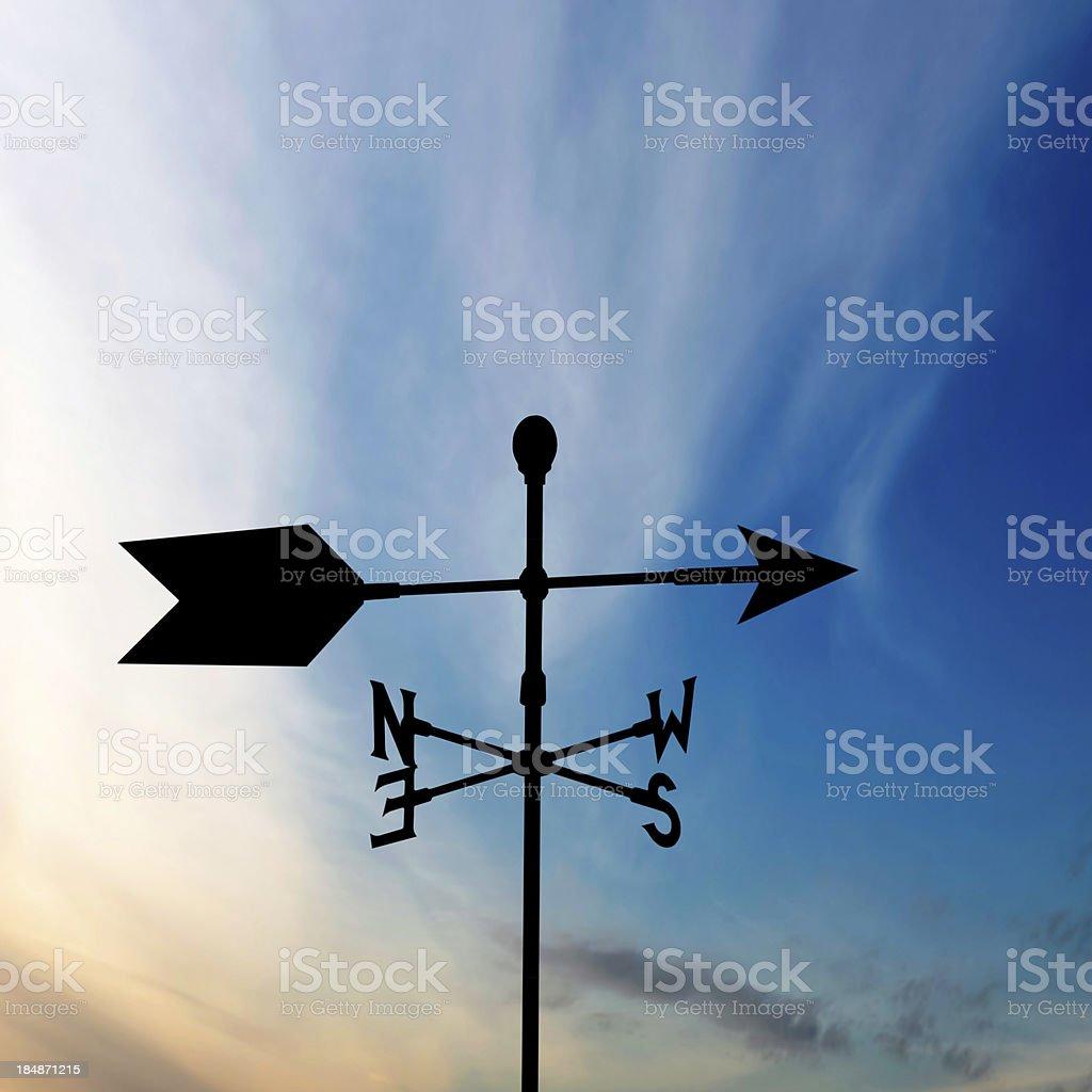 XL wind vane silhouette stock photo