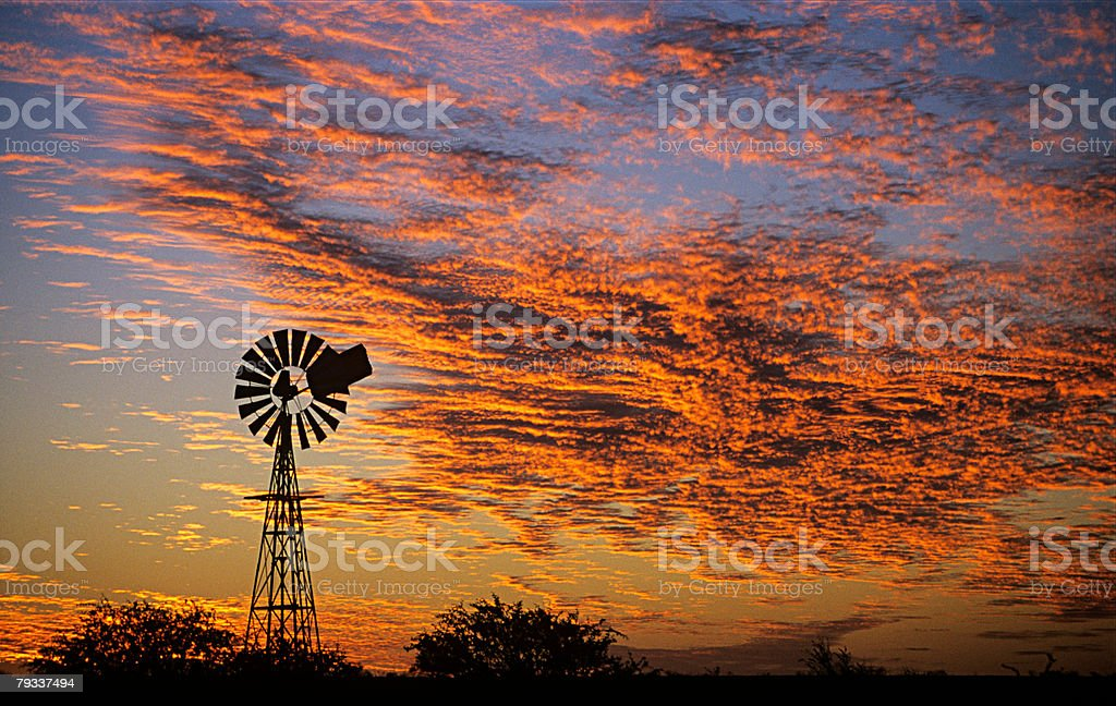 Wind wheel at sunset royalty-free stock photo