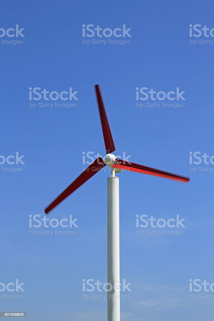 wind wheel in front of a blue foto stock royalty-free