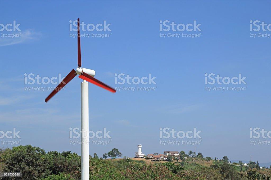 wind wheel in front of a blue photo libre de droits