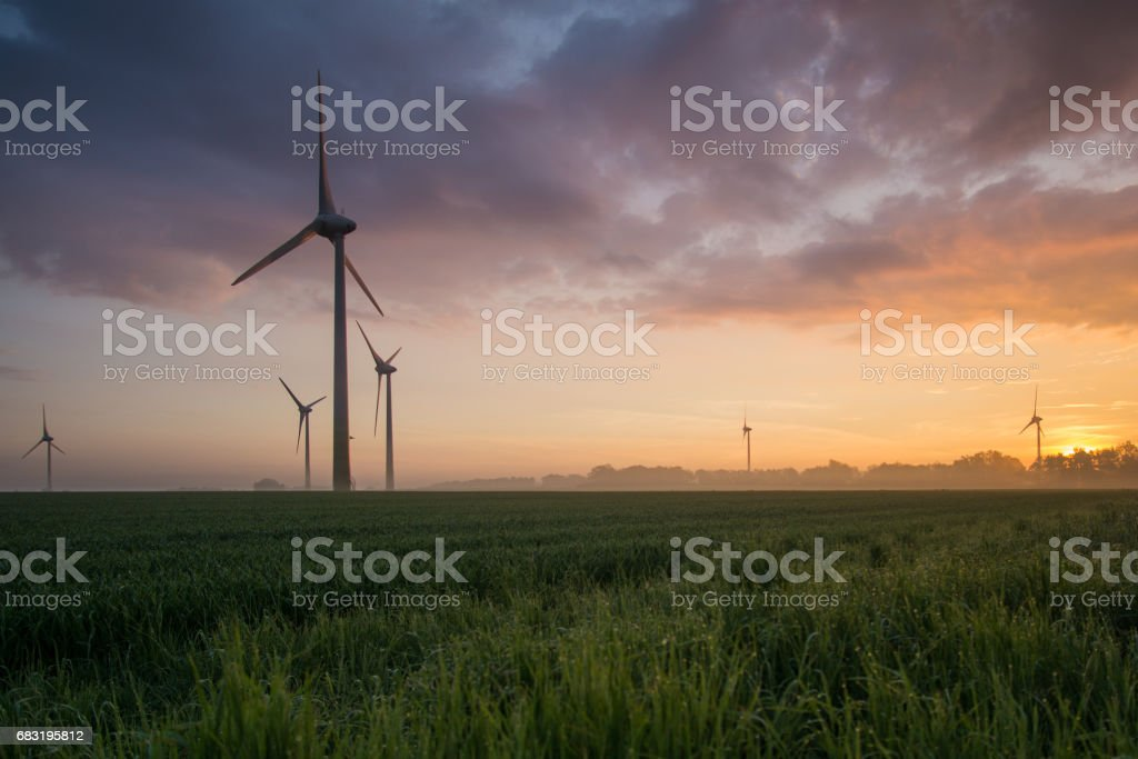 wind wheels at sunrise and fog with dark clouds royalty-free 스톡 사진