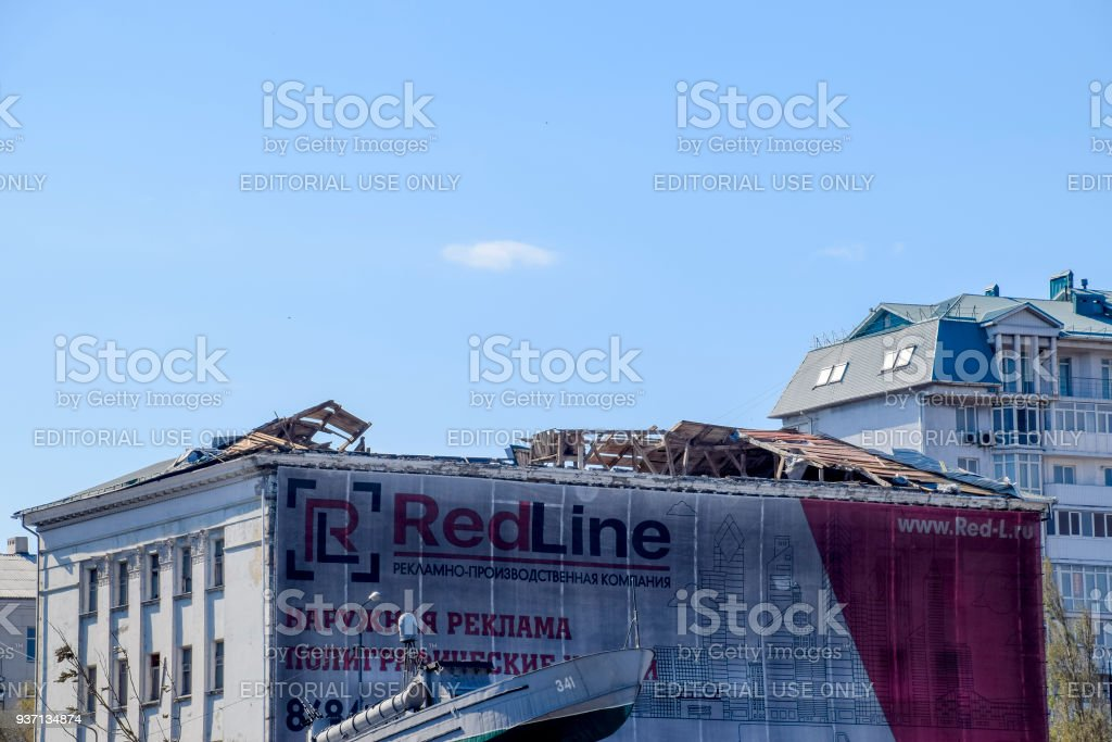 Wind-blown roof from the building. Destruction of the roof element of the house. Consequences of the hurricane. stock photo