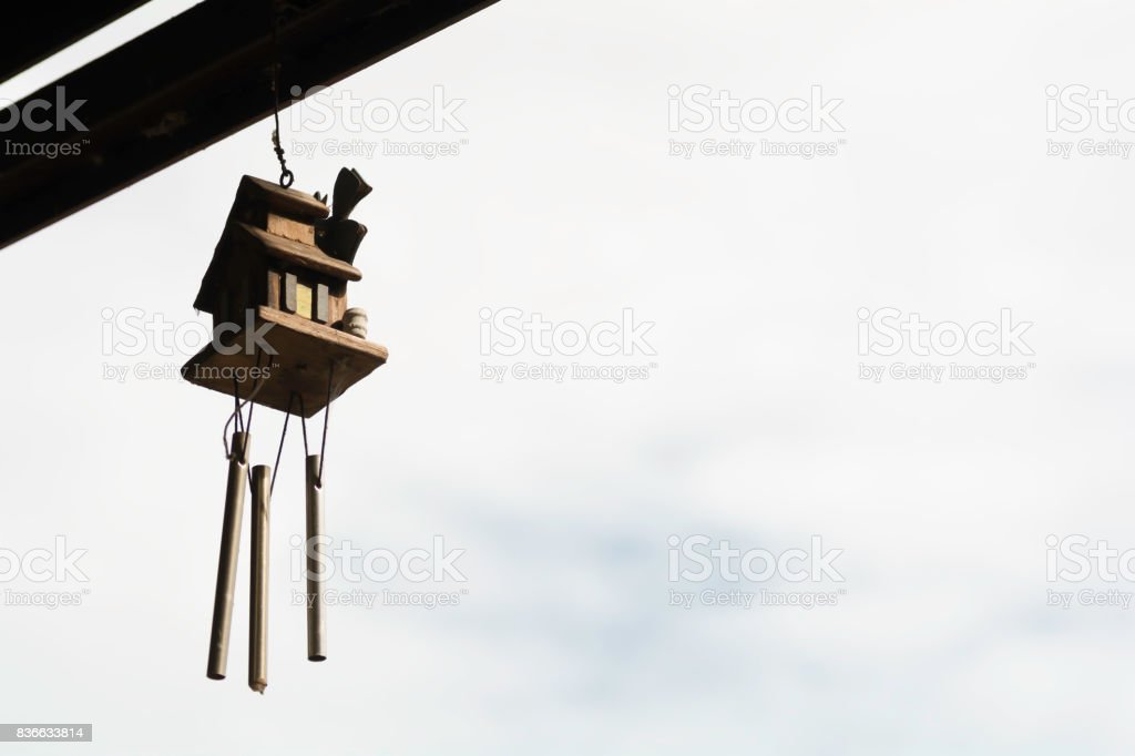 Windchimes hang on the window behind with sky  background. stock photo
