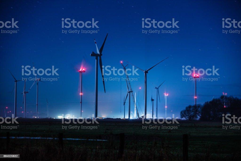 Windenergy turbines in Germany at night stock photo