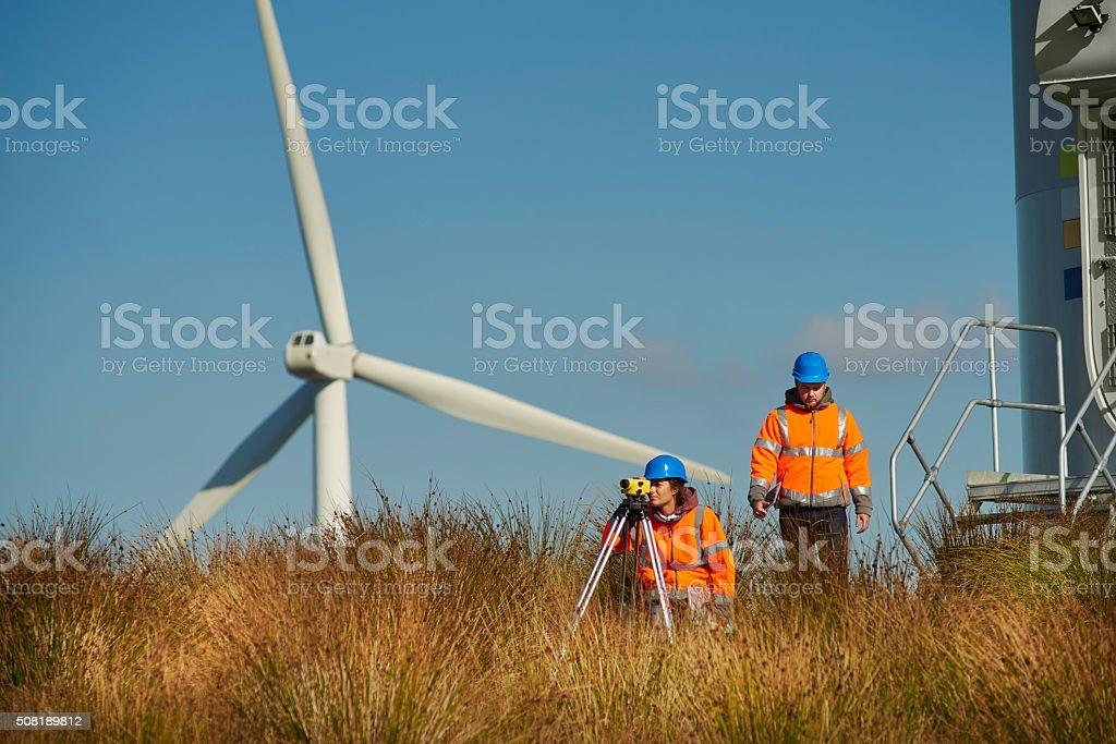 windfarm power engineers stock photo