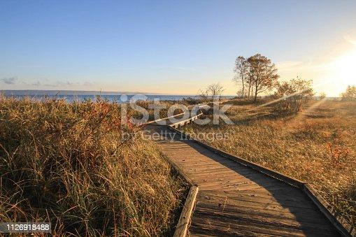 832047798istockphoto Winding Boardwalk Path Through Dune Grass On Lake Superior 1126918488