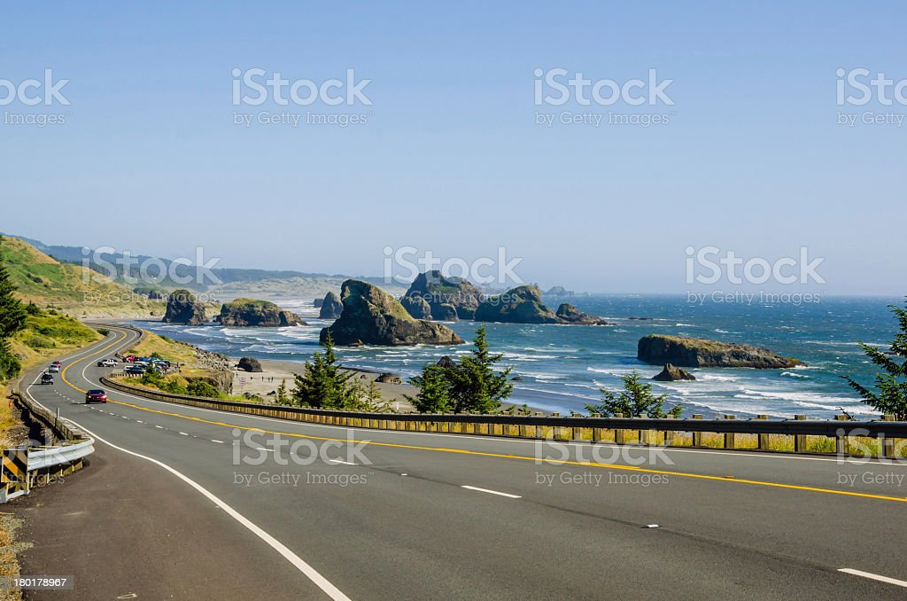 A winding coastal road on a clear day stock photo