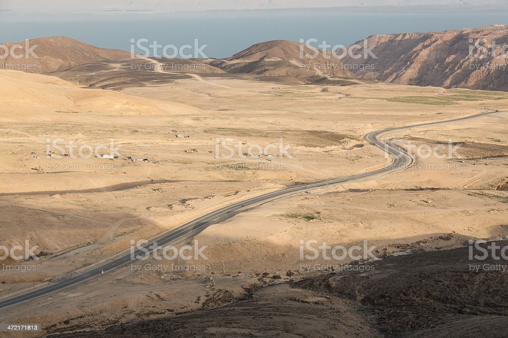 Winding desert road to the Dead Sea royalty-free stock photo