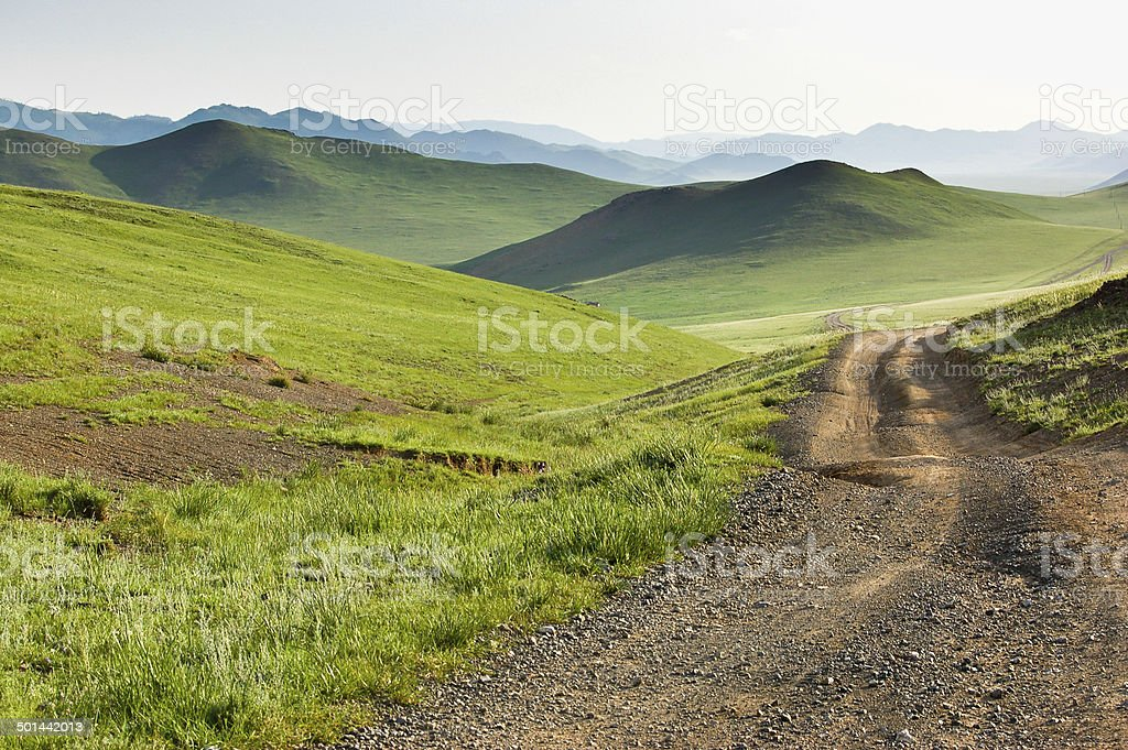 Winding dirt road through Central Mongolian steppe stock photo