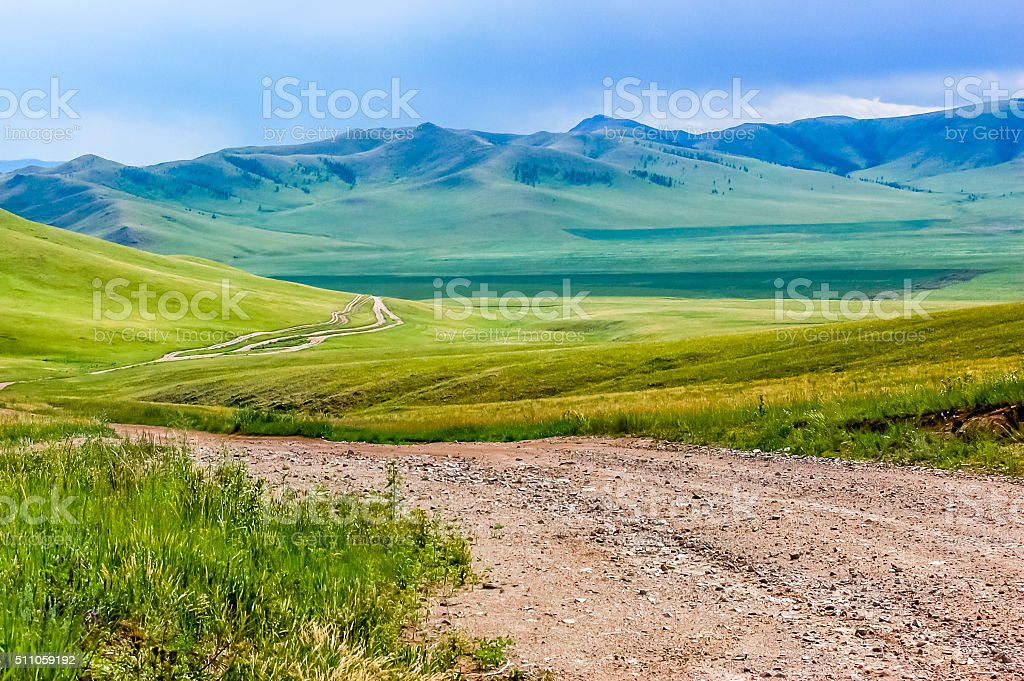 Winding dirt track in Mongolian steppe stock photo