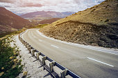 Winding empty road on the mountain with nature landscape background.