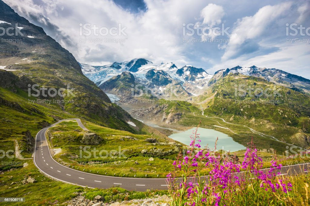 Winding mountain pass road in the Alps stock photo