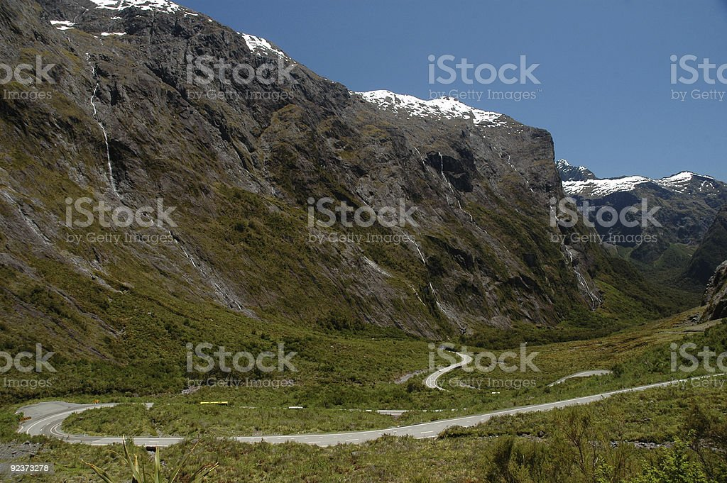 Winding Mountain Pass to Milford Sound, New Zealand royalty-free stock photo