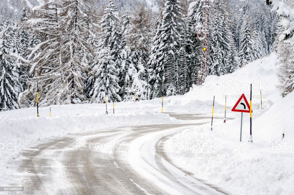 Winding Mountain Road Covered in Snow stock photo