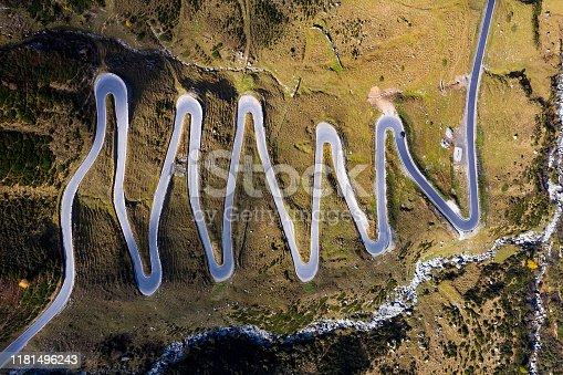 istock Winding Mountain Road in Swiss Alps, Aerial View 1181496243