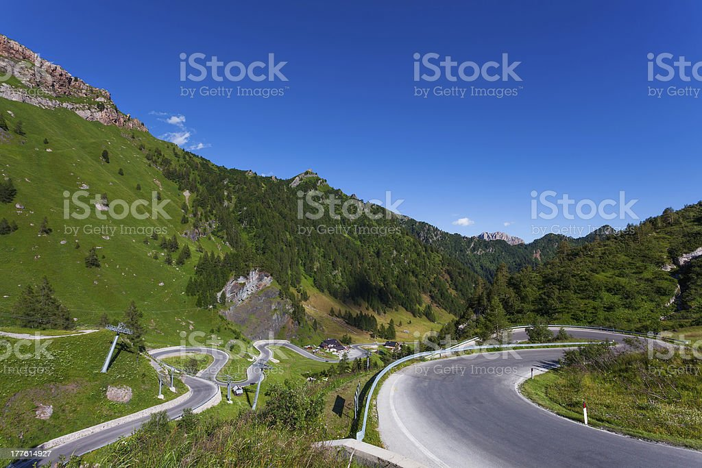 Winding, mountain road in the Dolomites, Italy. stock photo
