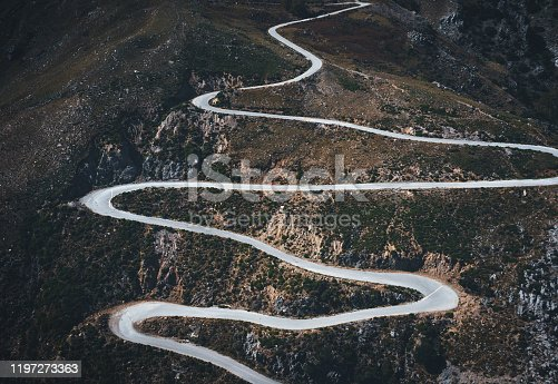 Aerial view on winding mountain road in south Chania region (Crete, Greece).
