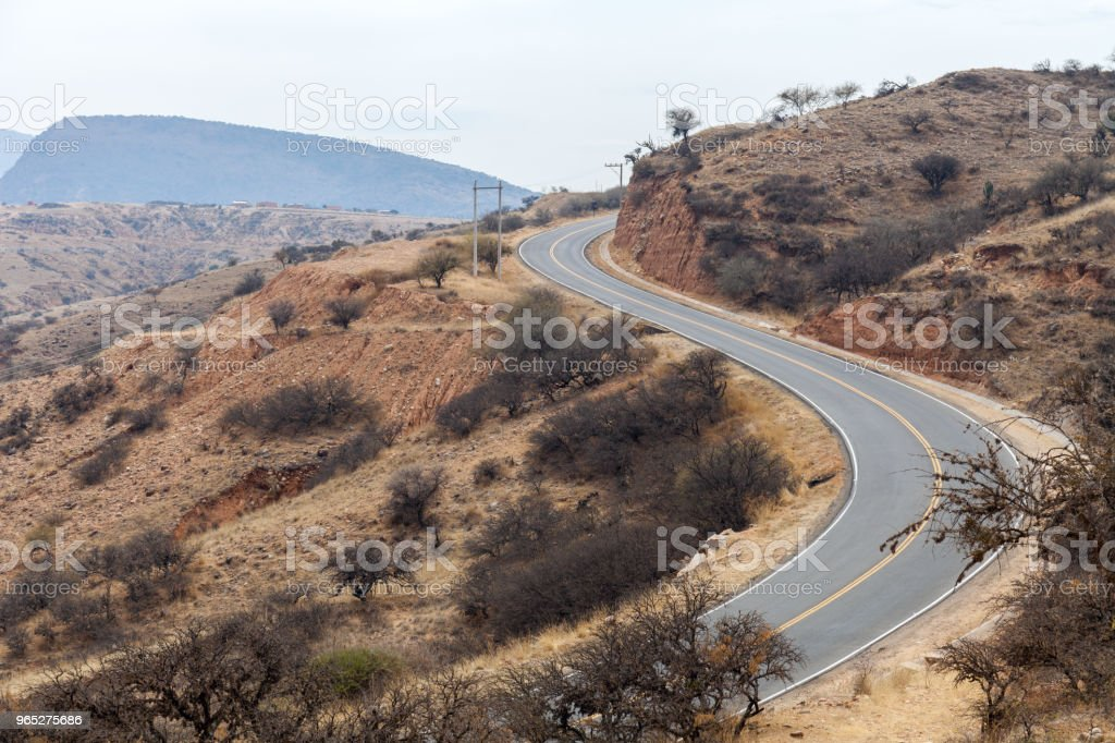 A winding mountain road running through the arid terrain of the Middle East royalty-free stock photo