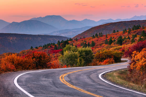 Winding mountain road with fall colors stock photo