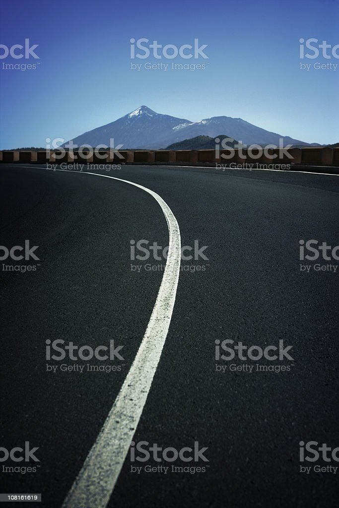 Winding Mountain Road with Teide Volcano in Background royalty-free stock photo