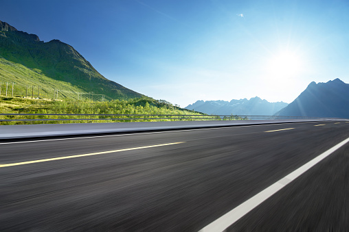 istock Winding mountain road without cars 1128162453
