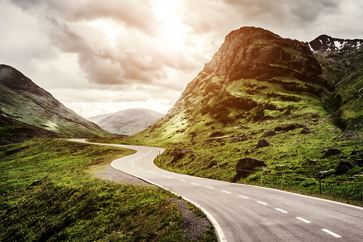 istock Winding mountain road without cars 1130625401