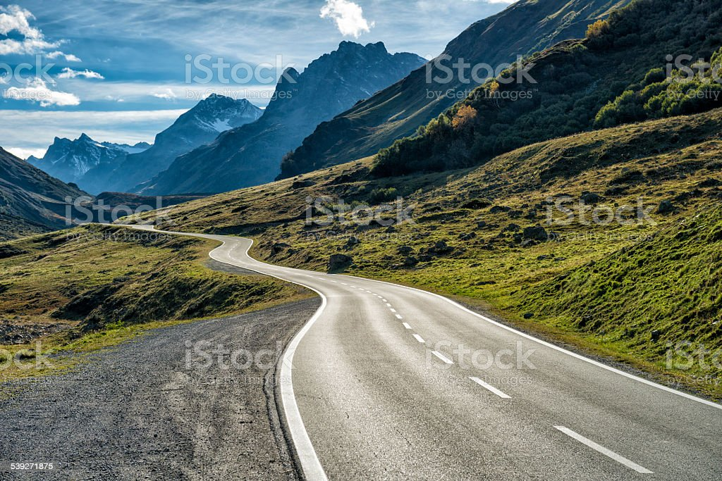 winding mountain road without cars stock photo