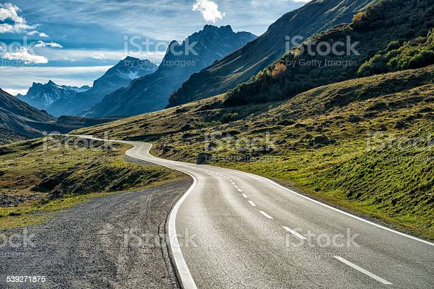 Photo of winding mountain road without cars