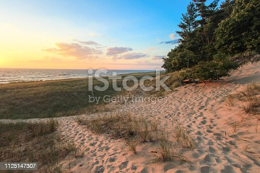 832047798 istock photo Winding Path On A Sunset Beach On Lake Michigan 1125147307