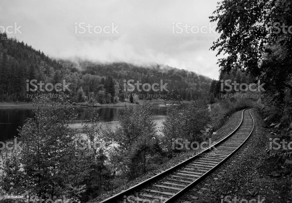 A winding railroad track in a mountain valley in autumn stock photo