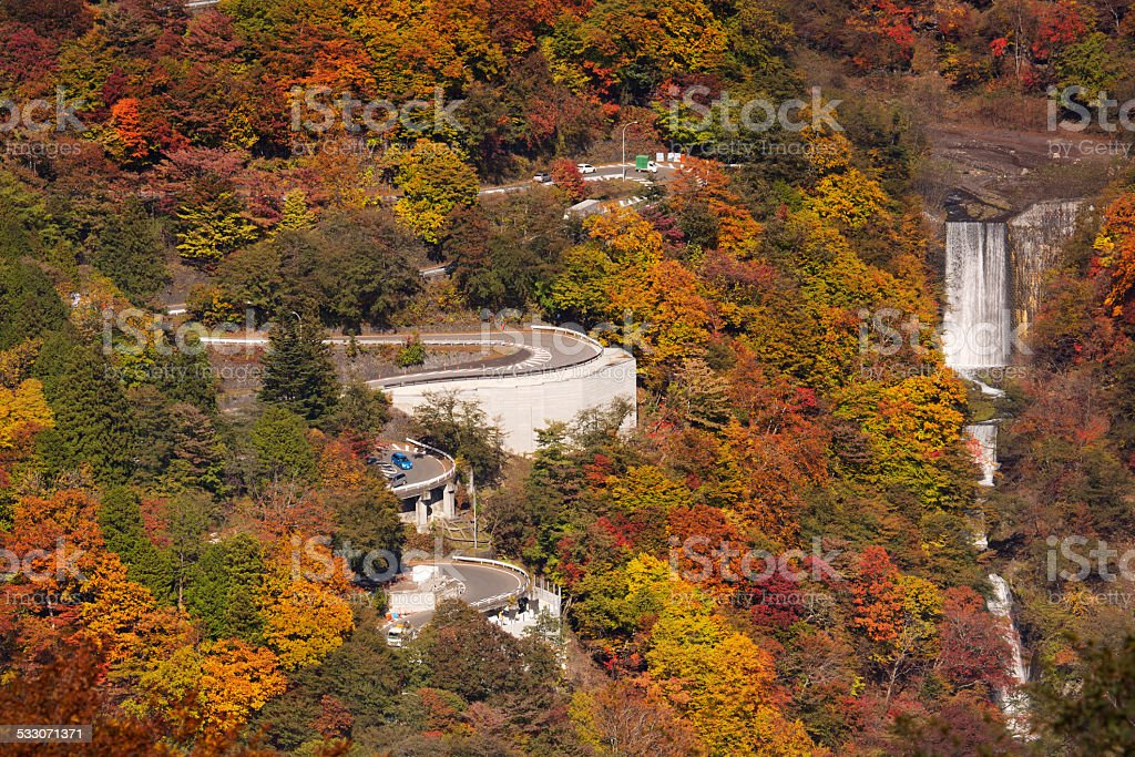 Winding road and autumn colours near Nikko, Japan stock photo