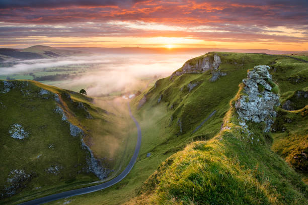 Winding Road At Sunrise In The Peak District. stock photo