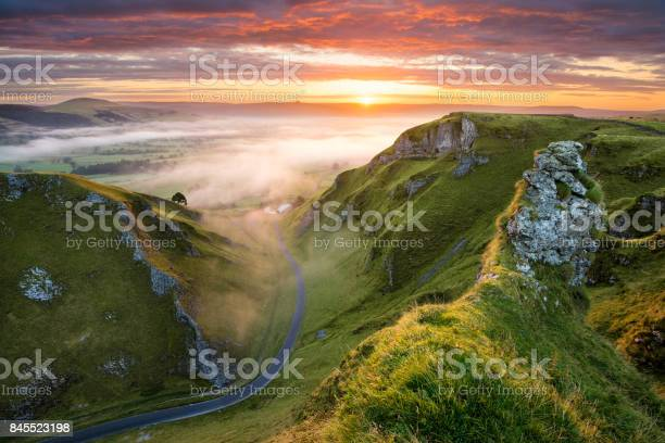 Photo of Winding Road At Sunrise In The Peak District.