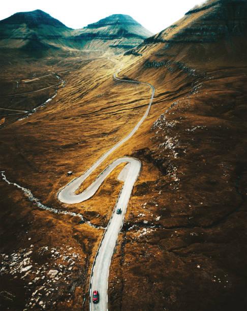 winding road at the faroe islands stock photo