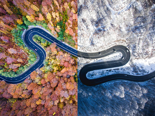 Winding road autumn vs. winter. Aerial view stock photo